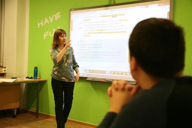 Norwegian teacher pointing to SmartBoard