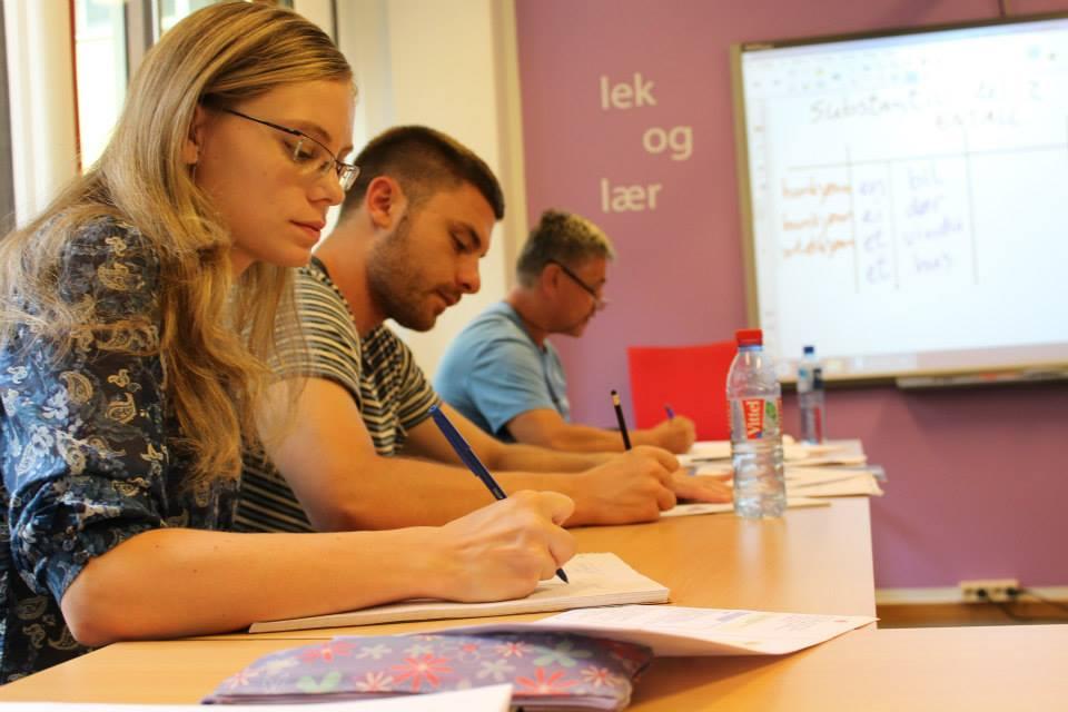 Norwegian teacher handing out note in class